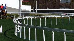Jockey riding horse to starting point Hong Kong Jockey club China Asia Stock Footage