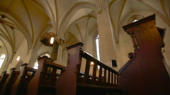 Dolly shot through a church nave past the benches - stock footage