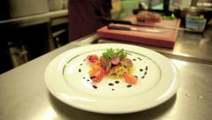 Chef Garnishing Tasty Pasta Entrée with Balsamico and Oil Stock Footage