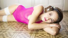 sexy woman on floor in pink - stock photo