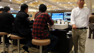 Stock Video Footage of Gamblers betting in air-conditioned member room Hong Kong Jockey club China Asia