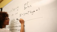Stock Video Footage of Clever student solving math problems on whiteboard