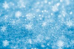 Stock Photo of blue glitter sparkles snow flakes background , super macro shot