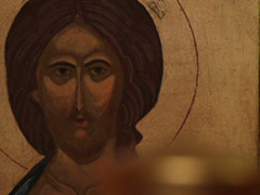 Prayer lighting candle praying jesus christ easter resurrection icon macro Stock Footage