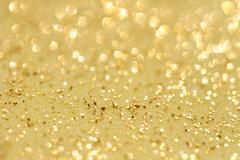 golden glitter sparkles dust  background - stock photo
