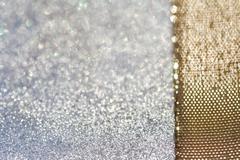 glitter sparkles dust and golden ribbon - stock photo
