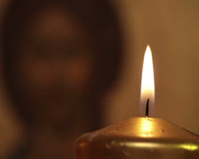 prayer blowing out candle praying jesus christ easter resurrection icon macro - stock footage