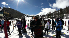 Time lapse of skiers in line at ski lift Stock Footage