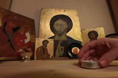 lighting tealight candles prayer praying jesus christ easter resurrection ico - stock footage