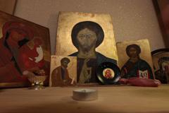 Prayer lighting three tealight candles praying jesus christ easter lent icon  Stock Footage
