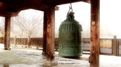 Buddist Bell Snowfall Stock Footage