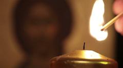 prayer lighting candle praying jesus christ easter resurrection icon macro - stock footage