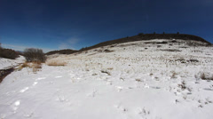 Slow pan shot of footprint tracks in snow - stock footage