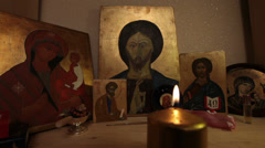 Prayer blowing out candle praying jesus christ easter resurrrection icon reli Stock Footage