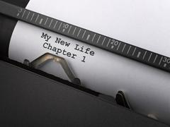 """""""my new life"""" message typed by vintage typewriter. Stock Photos"""