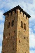 medieval tower built with bricks for the defense of the town by the barbarian - stock photo