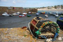 Fishing trap and anchored fishing botes in a harbor, low-tide, C Stock Photos