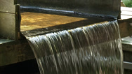 Stock Video Footage of Water flow and falling water from wooden waterway to water wheel