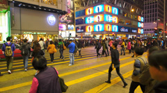 Hong Kong downtown commuters zebra crossing crowds crowded China Asia Stock Footage