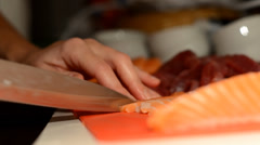 cutting slices of fish for sushi - stock footage