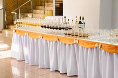 Banquet table with alcohol drinks and rows of stemware Stock Photos