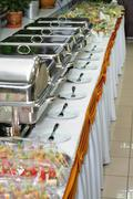 Chafing dish heaters at the banquet table Stock Photos