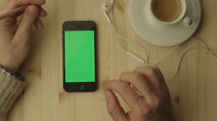 Phone with Green Screen Laying on a Table 2 Stock Footage