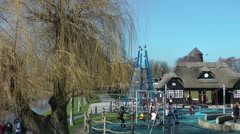 Children playing in play area at park HD Stock Footage