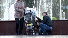 Young Family at a walk near the fountain. Nefteyugansk, Russia. Stock Footage