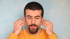 Young Man Listening Music Stock Footage