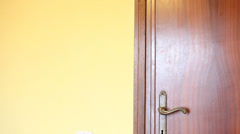 Furtive Man Appearing from The Door Stock Footage
