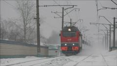 Passenger Train passing by closely lifting snow dust 2 Stock Footage