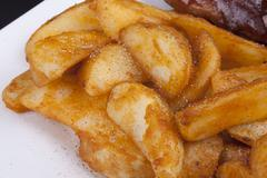 golden fried crisp potato wedges. - stock photo