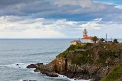 lighthouse of cudillero, asturias, northern spain - stock photo