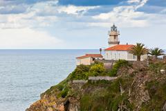 lighthouse of cudillero, asturias, northern spain - stock photo