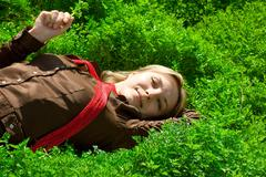 Lying in green grass - stock photo