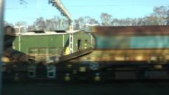 Industrial waste land out of window from moving train, HD 1080p Stock Footage