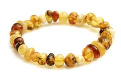 amber bracelet on white - stock photo