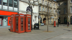 Red phone boxes in london England with old timey buildings HD Stock Footage