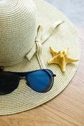 Hat, sunglasses and shells - stock photo