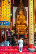 Man praying  in the the jade buddha temple shanghai china Stock Photos