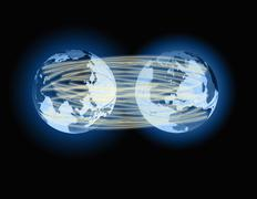 two globes linked by lines of light, representating global communication. - stock photo