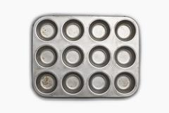 A well used, seasoned baking tray. cookware.  a cupcake or muffin tin. Stock Photos