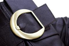 Golden buckle of leather brown boot Stock Photos