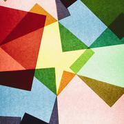 Multi-colored pieces of recycled construction paper. shapes, triangles and di Stock Photos