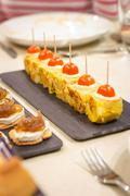 spanish omelet tapas and cheese with onion pinchos - stock photo