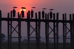 Monks on the u bein bridge, amarapura, myanmar Stock Photos