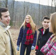 A group of four people outdoors on a winter day. Stock Photos