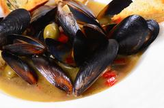 mussels tuscan with crispy ciabatta - stock photo