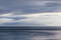 The sea and sky over puget sound in washington, usa. the horizon with light c Stock Photos